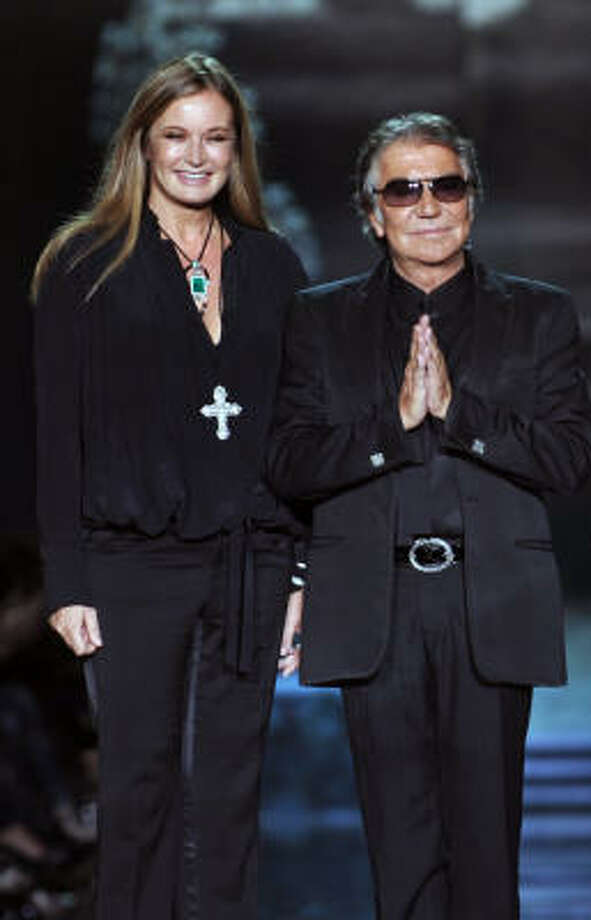 Italian fashion designers Roberto Cavalli and his wife Eva. Photo: FILIPPO MONTEFORTE, AFP/Getty Images