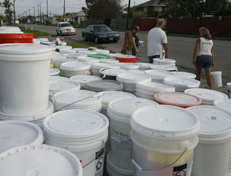 600 buckets of free cleaning supplies wait to be handed out at Moody Memorial First United Methodist Church in Galveston, Texas, on Wednesday morning. Photo: Kevin M. Cox, AP