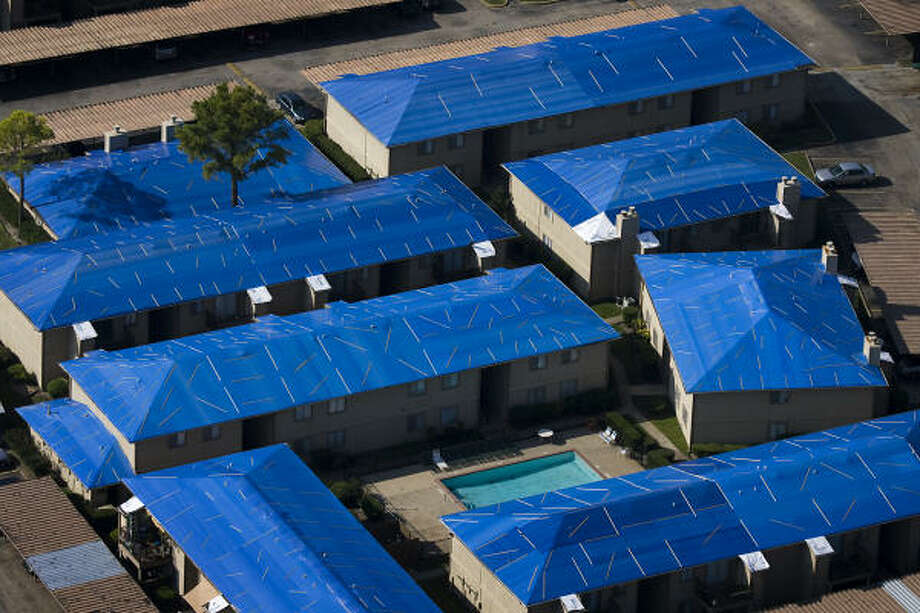 Blue tarps cover the roofs of apartments in southwest Houston. Photo: Smiley N. Pool, Chronicle