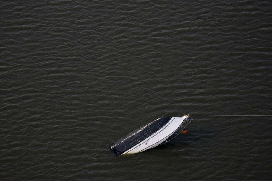 A capsized boat is seen in an aerial view near Tiki Island. Photo: Smiley N. Pool, Chronicle