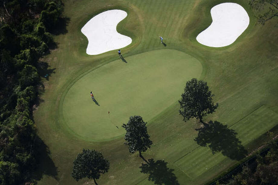 Golfers play at the course at the River Oaks Country Club in Houston. Photo: Smiley N. Pool, Chronicle