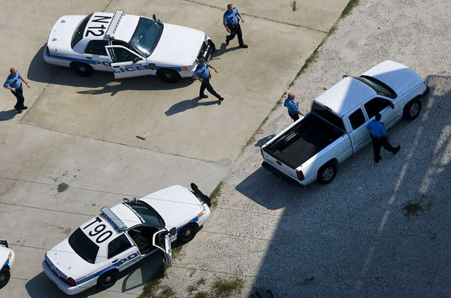 Houston Police surround a truck in a parking lot off of Interstate 45 near Beltway 8. Photo: Smiley N. Pool, Chronicle