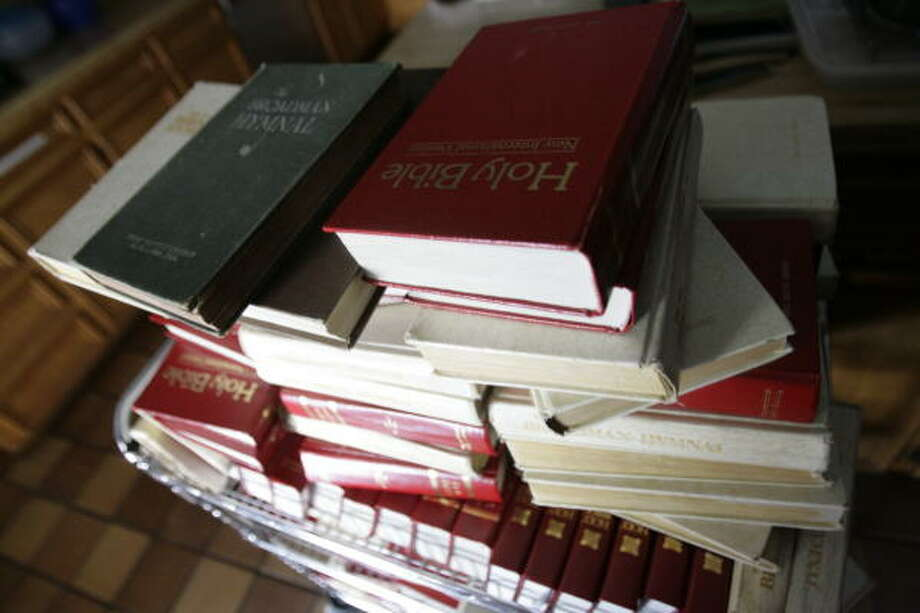 Of about 200 Bibles at the First Baptist Church of Alta Loma in Santa Fe, only a few survived  Hurricane Ike. Photo: Julio Cortez, Chronicle