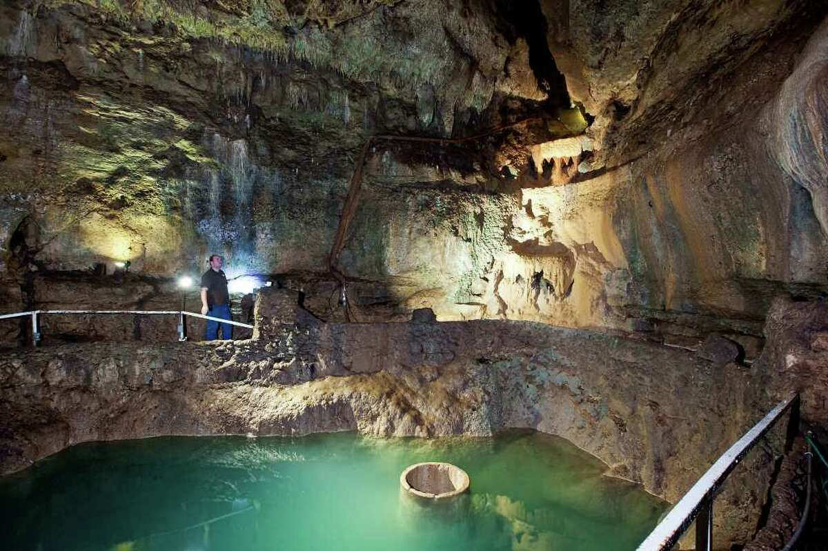 Cascad Caverns tour guide Josh Leerhoff looks towards the now dry waterfall in the Cathedral Rom on July 26, 2011. Photo by Marvin Pfeiffer
