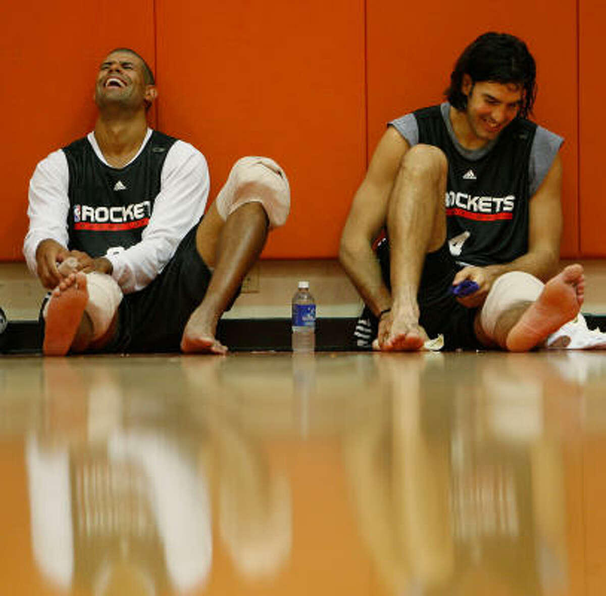 Rockets forward Shane Battier, left, shot 120 consecutive free throws after Sunday's practice to break a personal record.