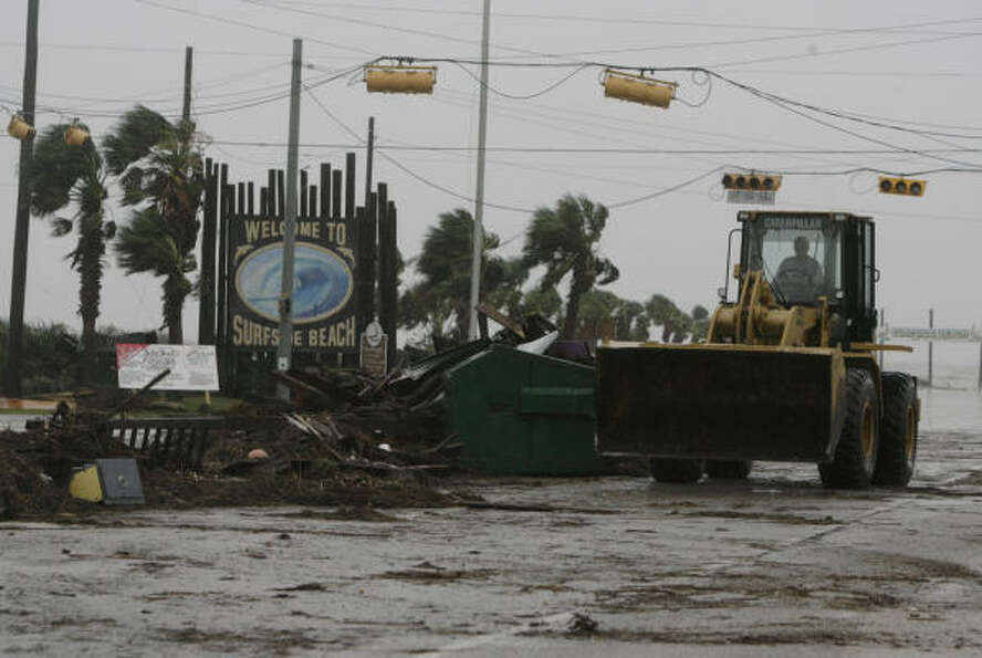 Crews clean up debris Sept. 13 left by Hurricane Ike in Surfside Beach.