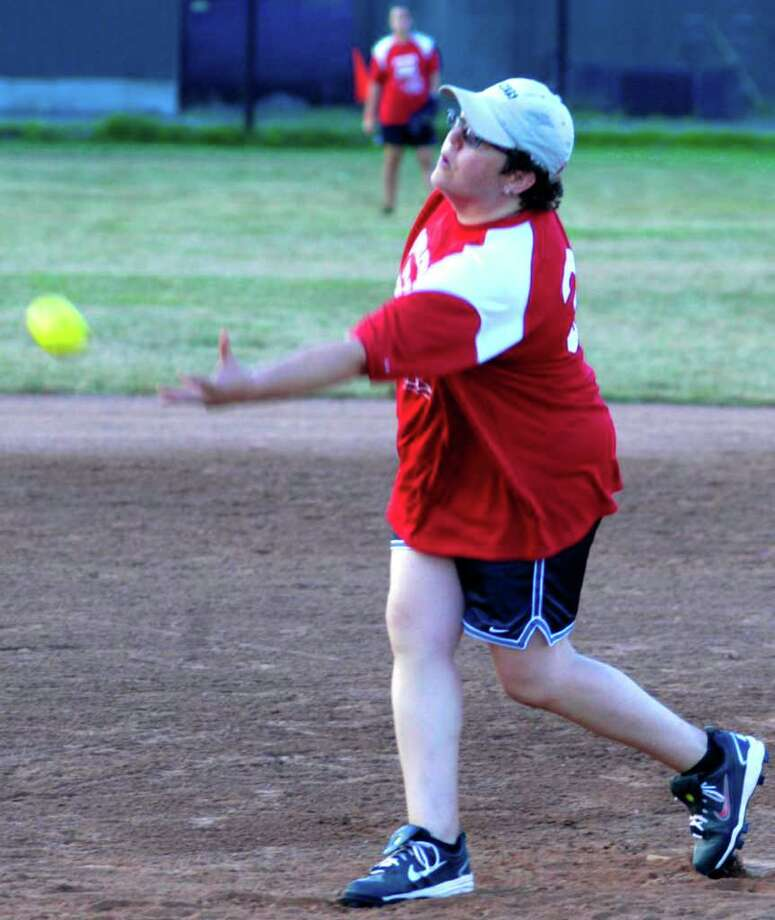 SPECTRUM/Karen Bain of Candlewood Valley Motors/Fat City dishes up a pitch on opening night of playoffs for New Milford Parks & Recreation's women's slowpitch softball league at Young's Field. Aug. 5, 2011 Photo: Norm Cummings