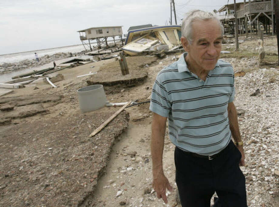 Congressman Ron Paul looks at the damage left behind by Hurricane Ike Sept. 15 on the west end of Surfside Beach. Paul, whose Presidential bid came to a stop after the primaries, owned property in and lived in Surfside Beach for 17 years. Photo: Julio Cortez, Chronicle