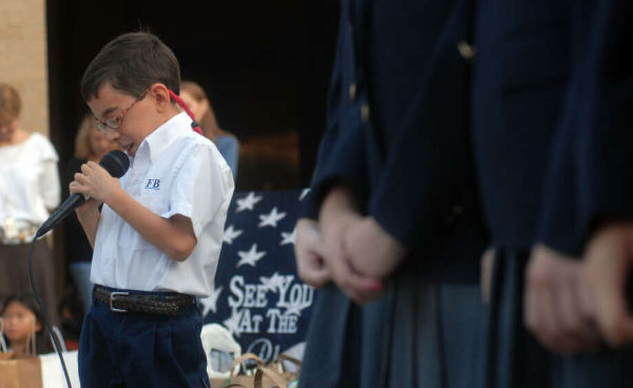 "First Baptist Academy student Mason Porter leads a prayer outside the school during the annual ""See Ya at the Pole"" day Wednesday, Sept. 24. Photo: Dave Rossman, For The Chronicle"
