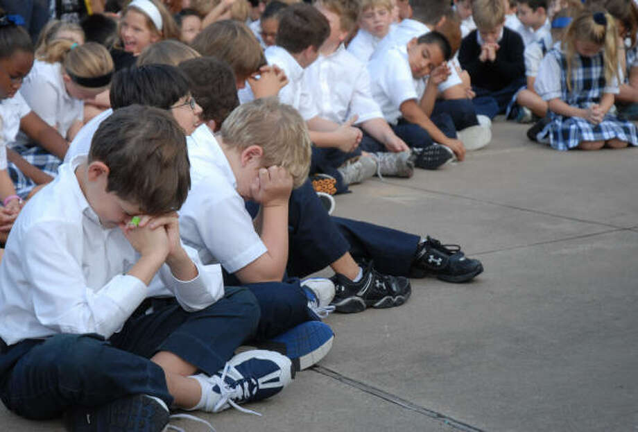 "First Baptist Academy students pray for Hurricane Ike victims outside the school during the annual ""See Ya at the Pole"" day Wednesday, Sept. 24. Photo: Dave Rossman, For The Chronicle"