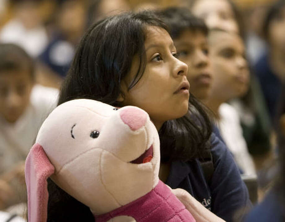 KIPP 3D Academy's Juana Flores (13 yrs. 6th grd) holds a stuffed animal on Tuesday at KIPP Houston southwest campus. KIPP 3D Academy relocated students to the southwest campus due to lack of power. Photo: James Nielsen, Chronicle