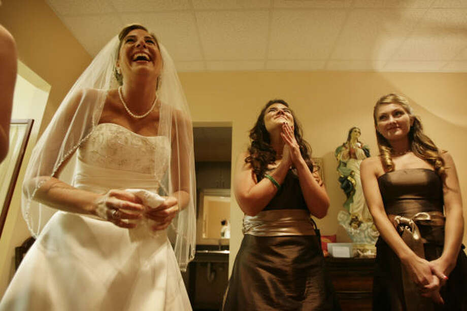 Amy Ransbottom, left, Laura Aleman and Anna Jones laugh before the beginning of Ransbottom's marriage at  St. John Vianney Catholic Church, Sept. 20, in Houston. The wedding went on despite Ike. Photo: Eric Kayne, Chronicle