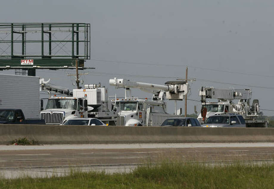 Electric utility trucks on their way to Galveston Island. Photo: Kevin M. Cox, AP/The Galveston County Daily News