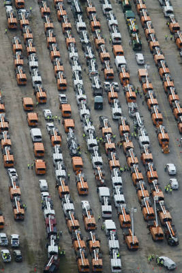 Hundreds of utility trucks are seen staged in a parking lot in response to Hurricane Ike, Monday, Sept. 15 in Houston. Photo: Smiley N. Pool, Chronicle