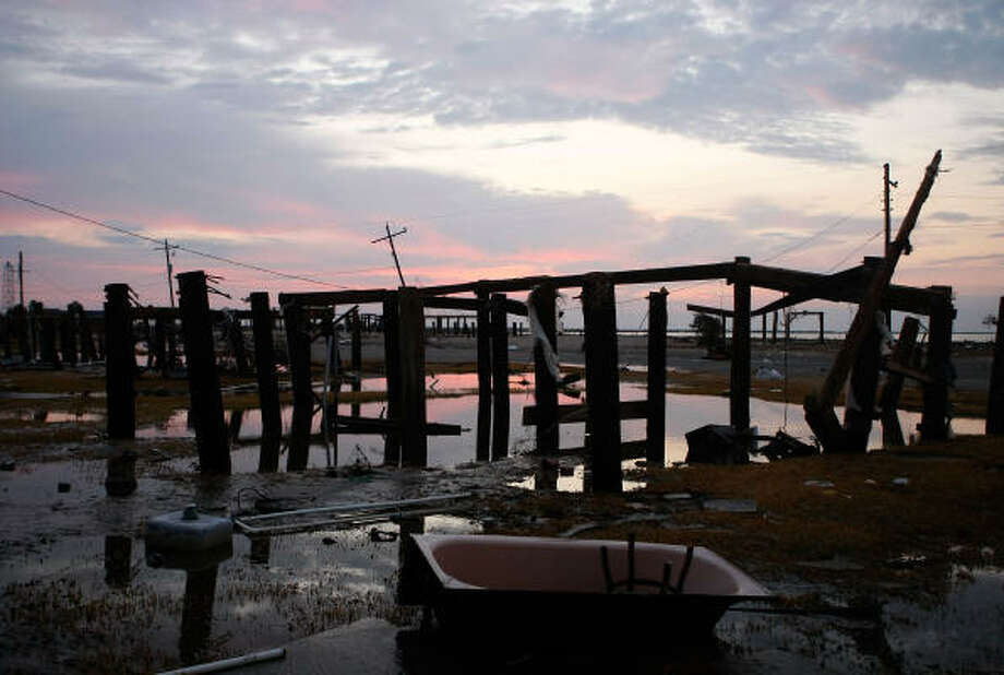 Pilings are the only thing left standing where a Bolivar beach house once stood. Photo: Mark Wilson, Getty Images