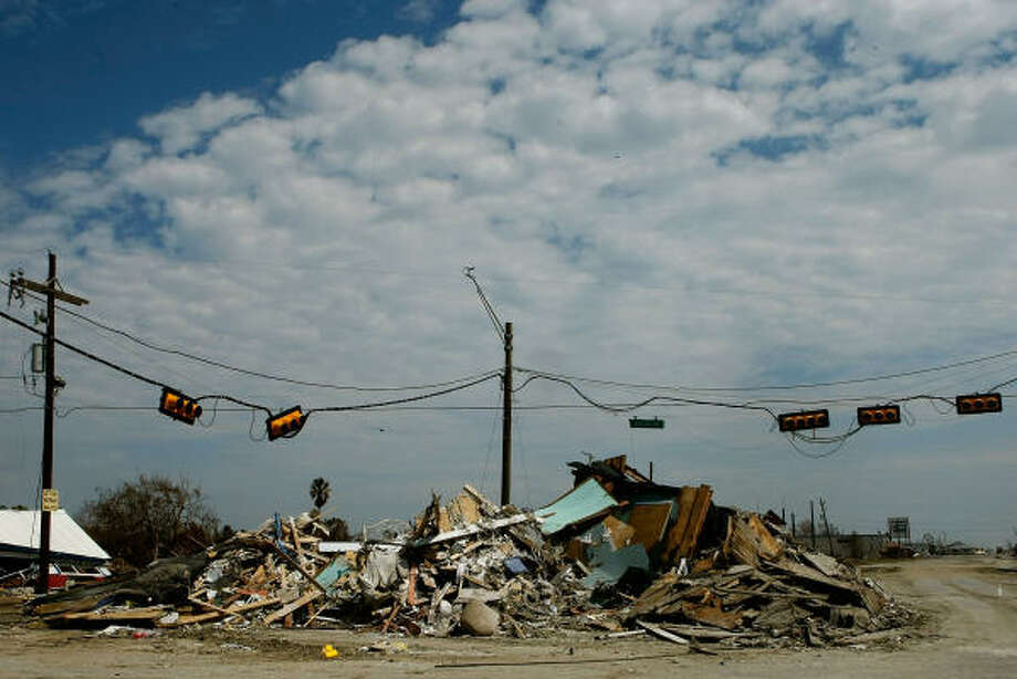 Hurricane Ike left debris from homes and businesses piled up on Highway 87 in Crystal Beach. Photo: Mark Wilson, Getty Images
