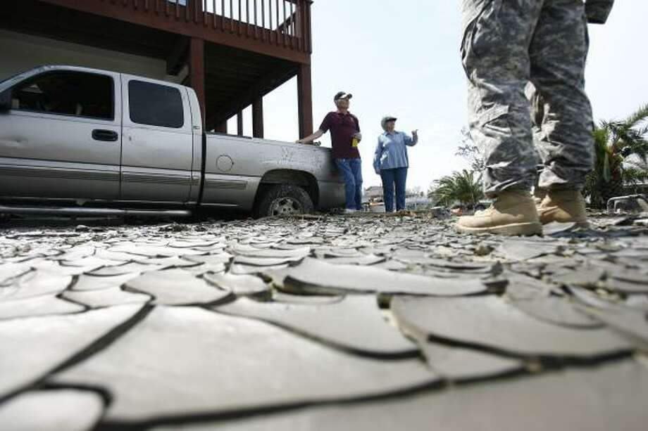 John R. and June Peveto talk to a soldier as they wait for a ride out of Crystal Beach after Hurricane Ike. The Texas National Guard was delivering Meals Ready to Eat and water to an estimated dozen people steadfastly remaining on the Bolivar Peninsula. Photo: Sharon Steinmann, Chronicle