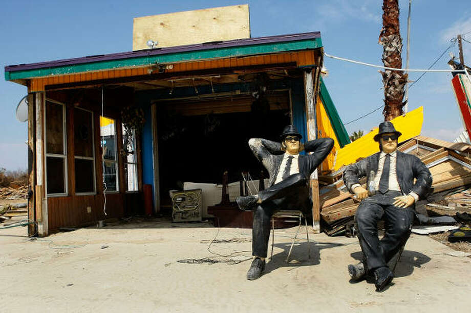 Sculptures of the Blues Brothers sit in chairs in front of a demolished bussiness on HWY 87, on September 18, 2008 in Crystal Beach. Photo: Mark Wilson, Getty Images