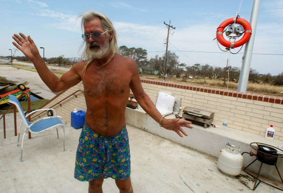Al Newman talks about how he and his girlfriend rode out Hurricane Ike at Crenshaw Middle School in Crystal Beach. Having lost his camper in the storm, he was still staying at the school after the storm. He said he is a naturalist and enjoys having neither power or people around. Photo: Mark Wilson, Getty Images