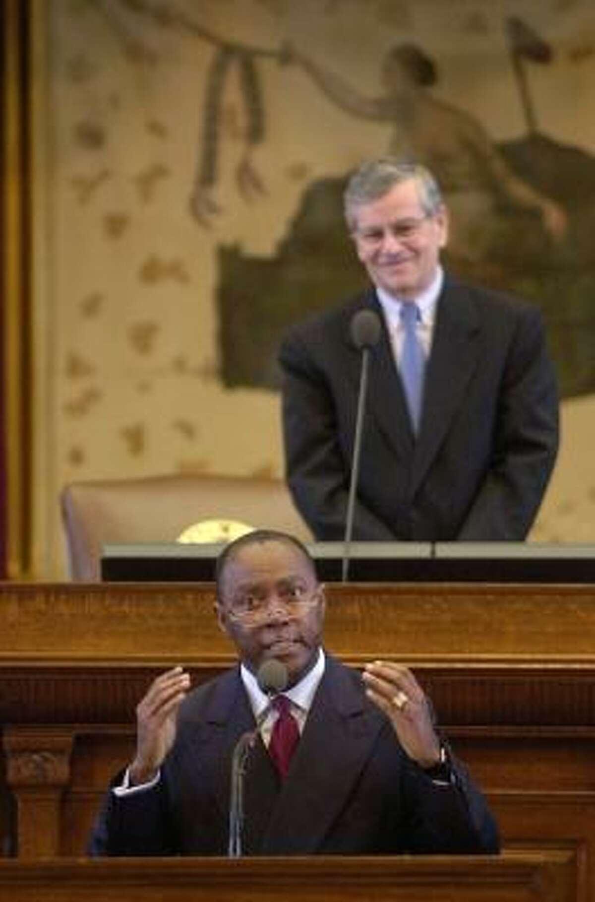 Rep. Sylvester Turner, D-Houston, shown addressing the state House in 2003, says he's still be loyal to Speaker Tom Craddick, background.