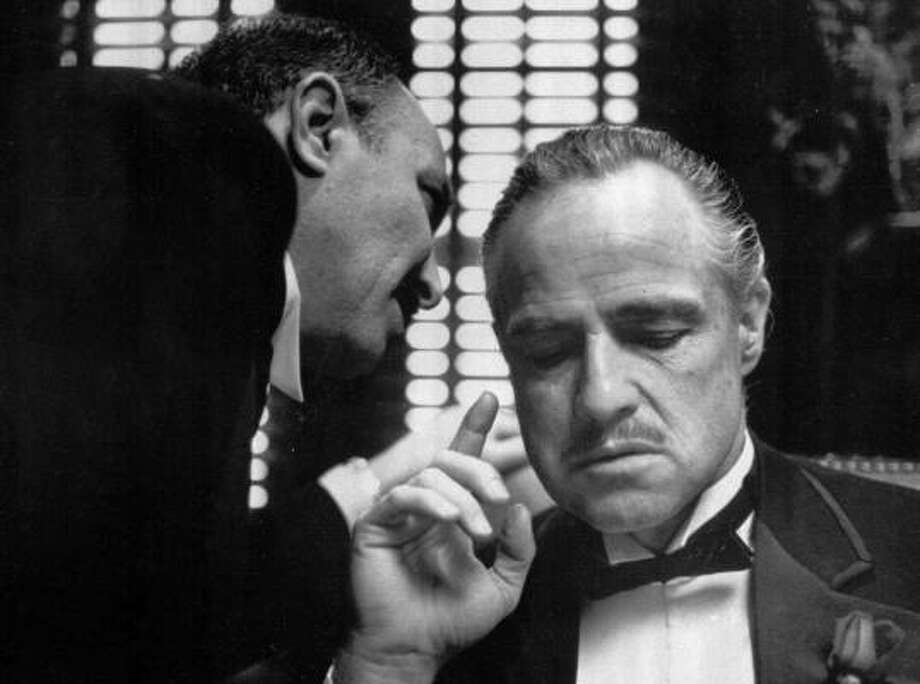Bonasera, portrayed by Frank Puglia, asks Don Corleone, portrayed by Marlon Brando, at right, for a favor in a scene from the 1972 movie The Godfather. Photo: Associated Press
