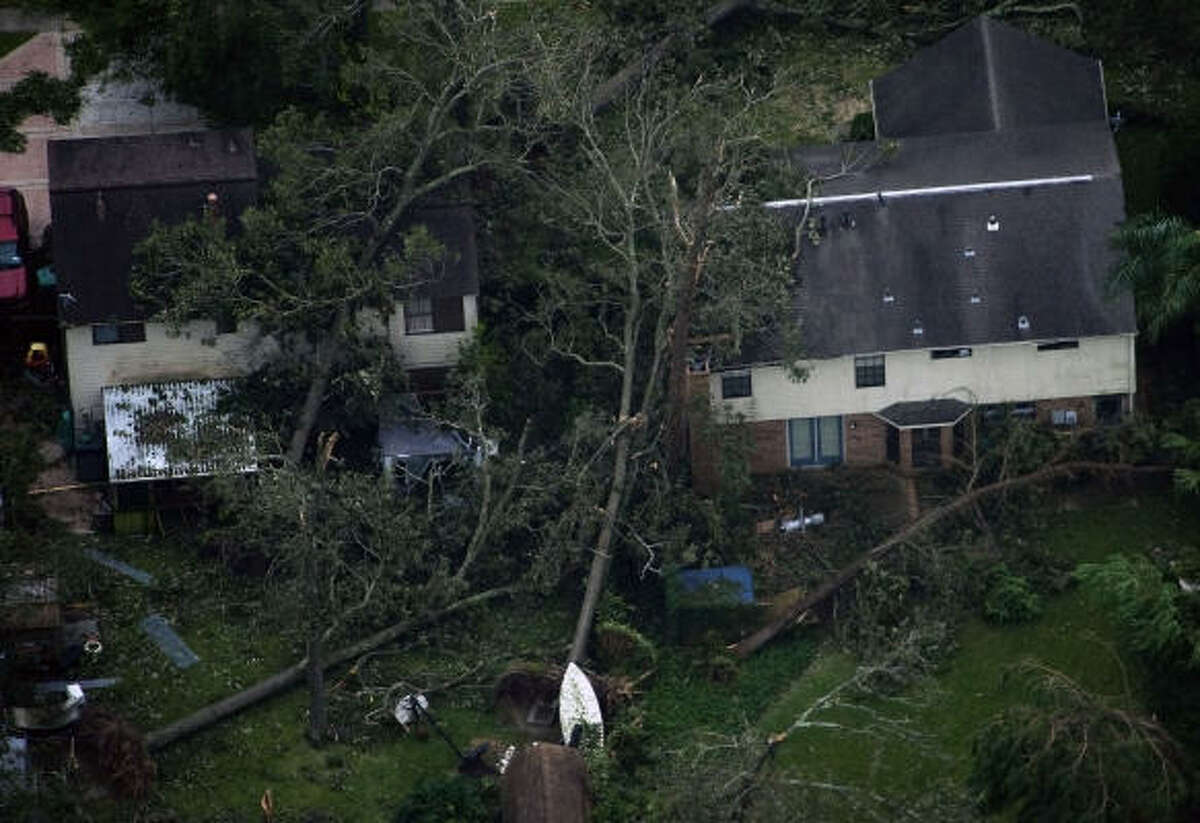 Fallen trees are seen against houses after the passing of Hurricane Ike in Seabrook.