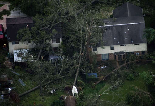 Fallen trees are seen against houses after the passing of Hurricane Ike in Seabrook. Photo: Smiley N. Pool, Chronicle