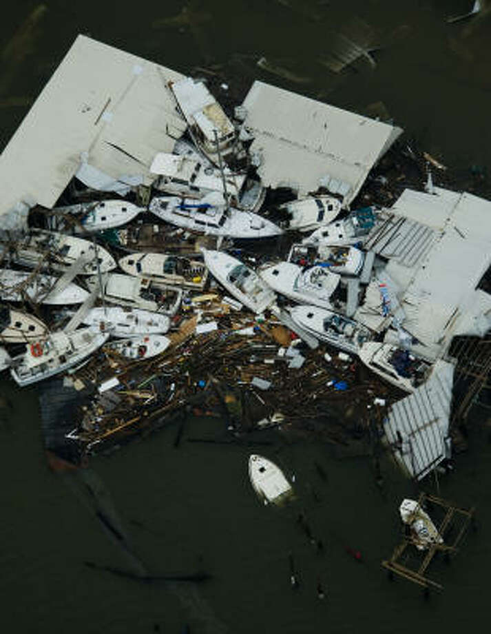Damaged boats are seen at a marina on Galveston Island after the passing of Hurricane Ike. Photo: Smiley N. Pool, Chronicle