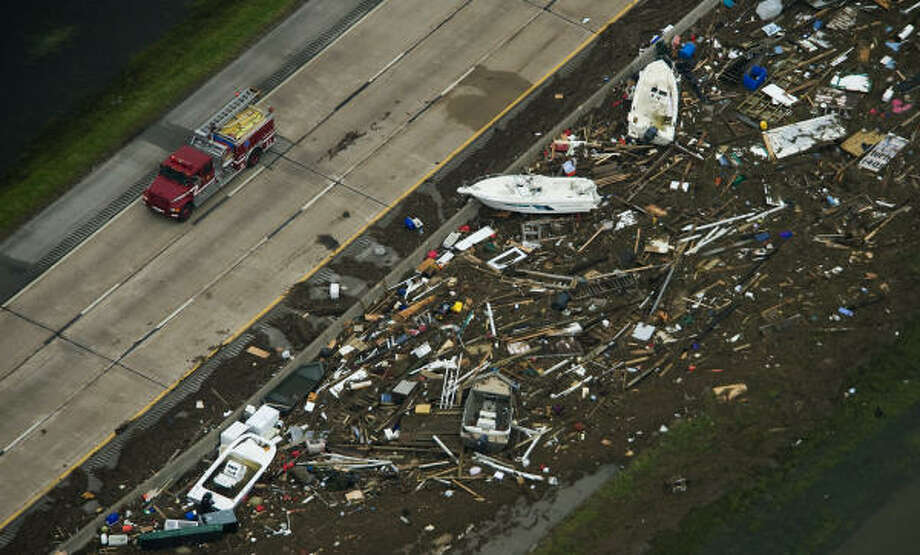 Debris covers Interstate 45 headed toward Galveston Island. Photo: Smiley N. Pool, Chronicle