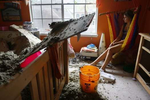 Alison Naquin's roof in her bedroom caved in during the storm, but all her family was gathered in the game room in the Green Tee subdivision after Hurricane Ike in Pearland. Photo: Mayra Beltran, Chronicle