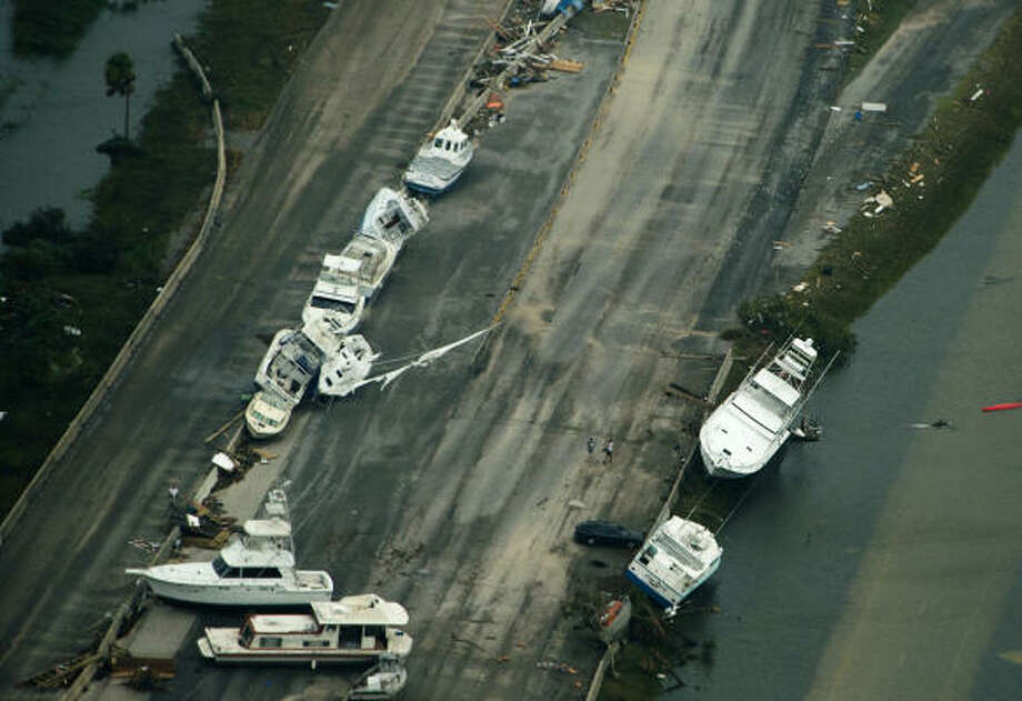 Boats sit on the roadway on Interstate 45 headed toward Galveston Island. Photo: Smiley N. Pool, Chronicle