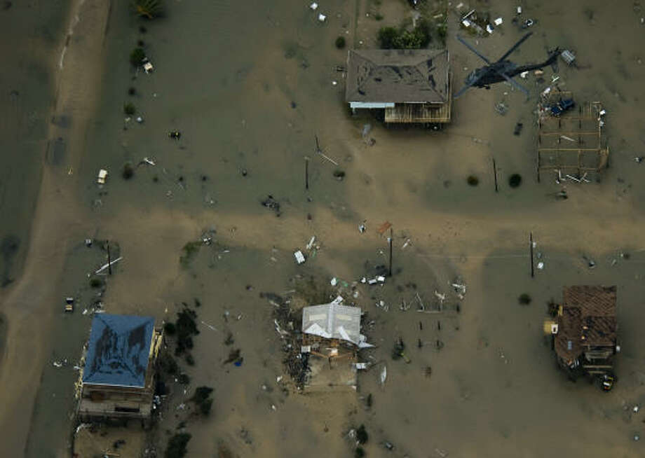 A rescue helicopter flies over damage after the passing of Hurricane Ike in Crystal Beach. Photo: Smiley N. Pool, Chronicle