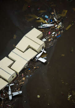 Debris surrounds damaged aircraft and hangars at Scholes Field on Galveston Island after the passing of Hurricane Ike, Saturday. Photo: Smiley N. Pool, Chronicle