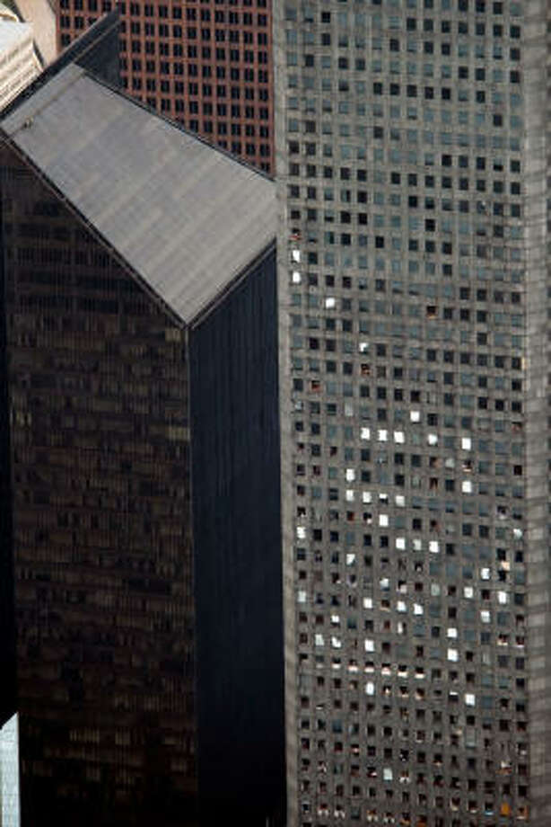 Windows that sustained blown-out glass can be seen in the J.P. Morgan Chase Tower in downtown Houston. Photo: Smiley N. Pool, Chronicle