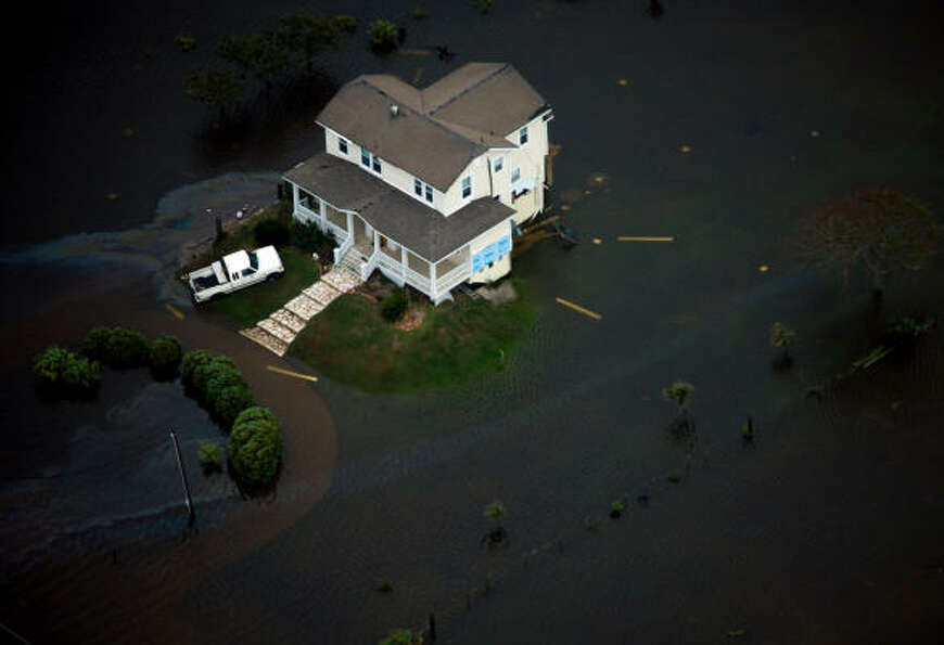 A house is seen surrounded by floodwater on Galveston Island after the passing of Hurricane Ike.