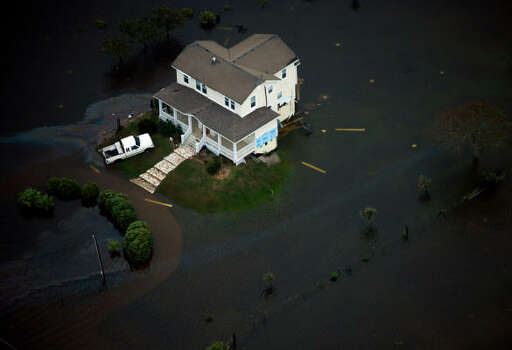 A house is seen surrounded by floodwater on Galveston Island after the passing of Hurricane Ike. Photo: Smiley N. Pool, Chronicle