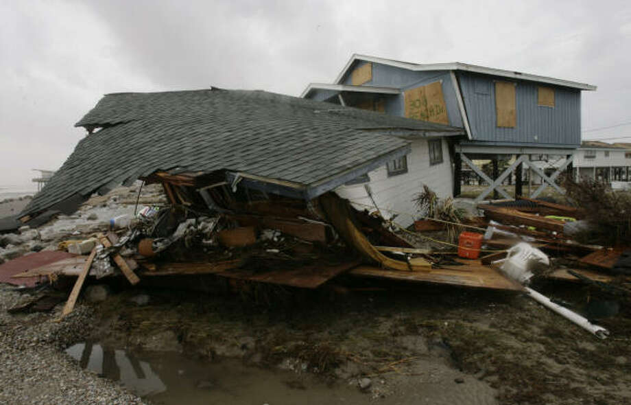 A house that floated in floodwaters during Ike wound up stopped by another home in Surfside Beach Sept. 13. Photo: Julio Cortez, Chronicle