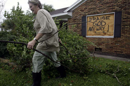 Despite being forced to clean debris in the front yard of her house, Karen Gerdes, of La Marque, was grateful she survived Ike. Photo: Eric Kayne, Chronicle