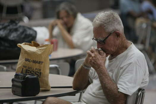 Ike evacuees rest in the cafeteria at Ball High School on Sept. 13. Photo: Melissa Phillip, Chronicle