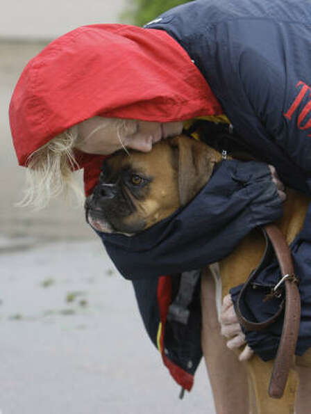 Frederika Kotin hugs her dog, Belle, after they fled a house  fire in Galveston on Sept. 13.