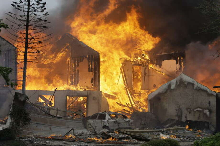 One of six townhomes on Beaudelaire Circle in Galveston burns after Hurricane Ike on Sept. 13. Photo: Melissa Phillip, Chronicle