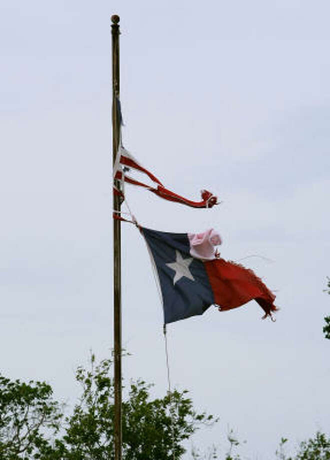 A Texas flag tattered by Hurricane Ike flies over a Texas City home. Photo: Mark Wilson, Getty Images