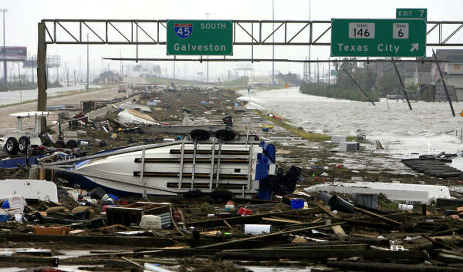 Debris, boats and trailers line the southbound lanes of I-45 after Hurricane Ike struck the area. Photo: Eric Kayne, Chronicle