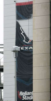 Damage at Reliant Stadium prompted the postponement and possibly the relocating of Monday's game between the Texans and Baltimore Ravens. Photo: Billy Smith II, CHRONICLE