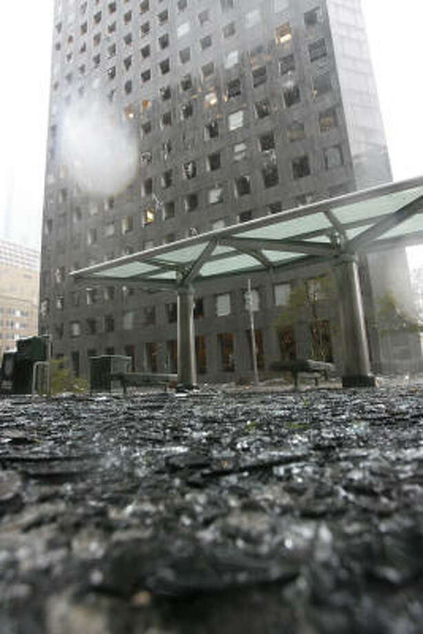Glass litters the street after the JP Morgan Chase Tower was heavily damaged by Hurricane Ike. Photo: James Nielsen, Chronicle