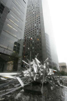 Window blinds litter the street after the JPMorgan Chase Tower was heavily damaged by Hurricane Ike. Photo: James Nielsen, Chronicle