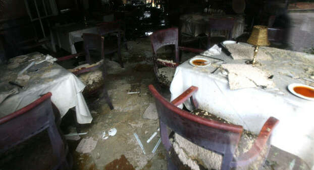 The interior of Brennan's suffered extensive damage from the overnight blaze. Photo: Billy Smith II, CHRONICLE