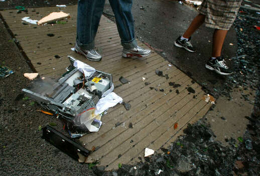 A computer lies broken on the street in front of the JP Morgan Chase Tower after Hurricane Ike passed through Houston on Sept. 13. Photo: Mark Wilson, Getty Images