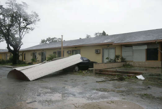 The awning of a building in Freeport wound up on top of the only car left in the parking lot during Hurricane Ike. Images of damage in Galveston. |  See yesterday's pictures. Photo: Julio Cortez, Chronicle
