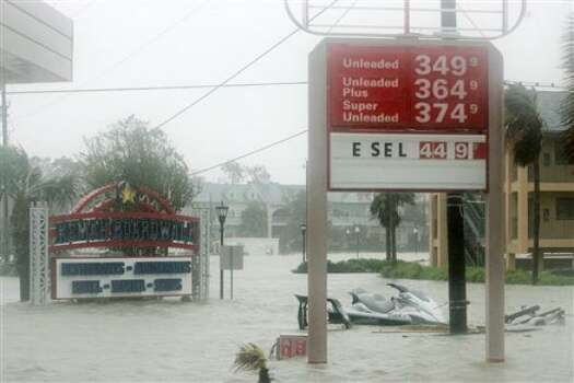 A service station is flooded along the main street in Kemah. Photo: Marcio Jose Sanchez, AP